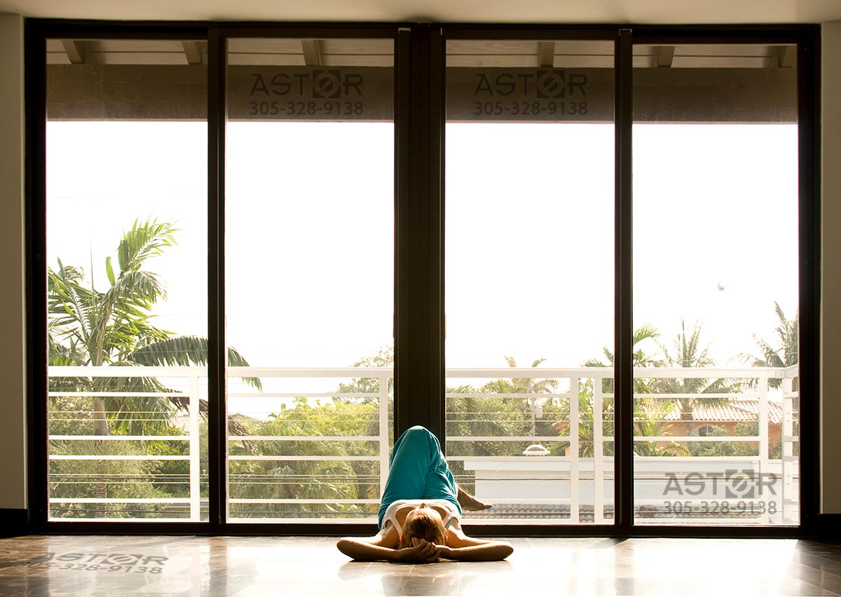 Picture of impact resistant sliding glass doors in dark bronze finish in Miami, Florida.